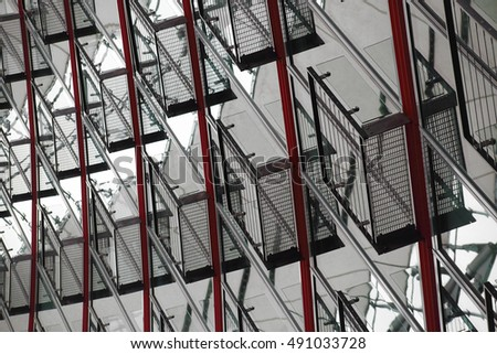 Contemporary metal architecture with grid structures and reflections. Multilevel industrial interior.