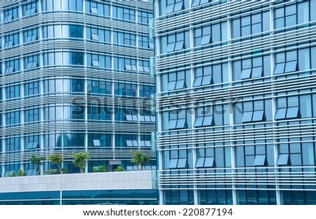 Contemporary office building blue glass wall detail - stock photo