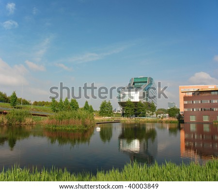 Contemporary Office Building, reflected in a pond - stock photo