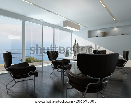 Contemporary office conference room interior with scattered armchairs around a central table in front of a glass wall overlooking the ocean and an esasel on a stand in the corner