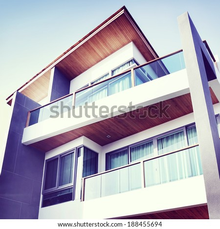 Contemporary Residential Building Exterior in the Daylight - stock photo