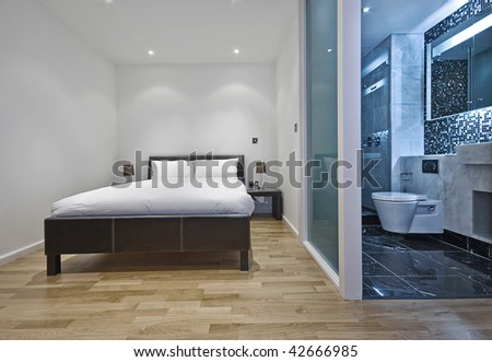 contemporary studio apartment with bedroom and bathroom view - stock photo