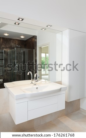 Contemporary white bathroom furniture, shelves and sink
