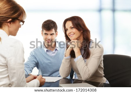 Contemporary young couple get financial advise. - stock photo
