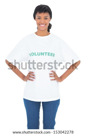 Content black haired volunteer posing with hands on the hips on white background - stock photo