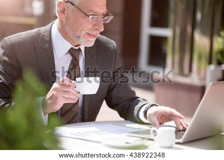 Content businessman drinking coffee - stock photo