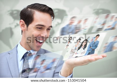 Content businessman looking at pictures on digital screen on map background - stock photo