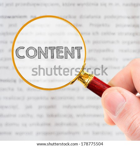 Content. Hand holding classic styled magnifying glass, with Content sign. - stock photo