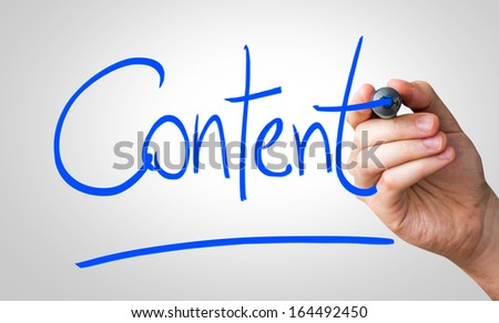 Content hand writing with a blue mark on a transparent board - stock photo