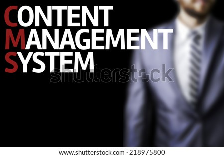 Content Management System written on a board with a business man on background - stock photo