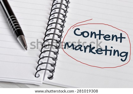 Content Marketing word on notebook page - stock photo