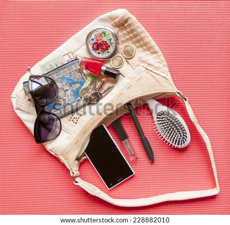 Content of one white female bag. Necessary things. - stock photo
