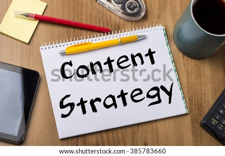 Content Strategy - Note Pad With Text On Wooden Table - with office  tools - stock photo