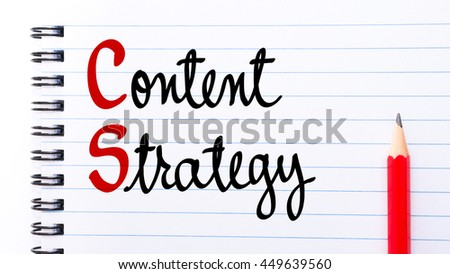Content Strategy written on notebook page with red pencil on the right