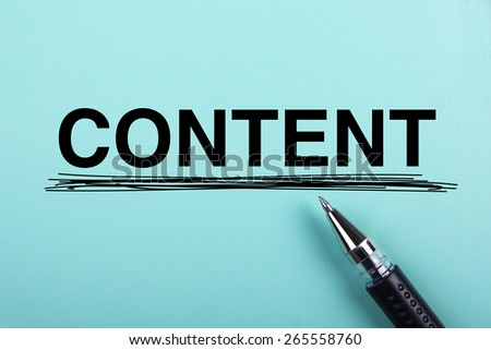 Content text is on blue paper with black ball-point pen aside. - stock photo