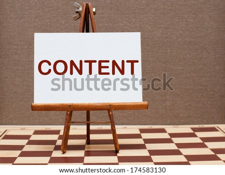 Content word written on easel  - stock photo