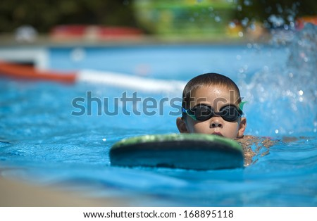 Contestant receives instructions from their coach while in the pool. - stock photo