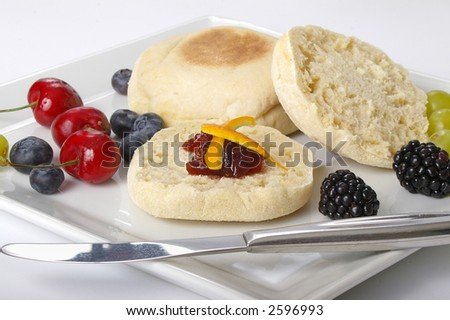 Continental breakfast plate of fruit & muffins. - stock photo