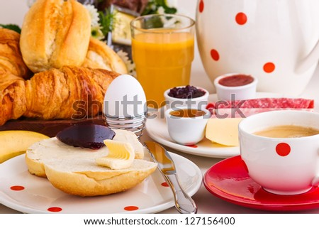 continental breakfast with coffee, cheese,jelly,bread rolls... - stock photo