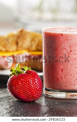 Continental breakfast with croissant  and strawberry smoothie