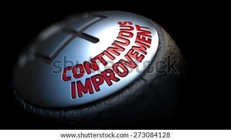Continuous Improvement. Shift Knob with Red Text on Black Background. Close Up View. Selective Focus. 3D Render. - stock photo