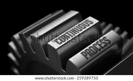 Continuous Process on the Metal Gears on Black Background.  - stock photo