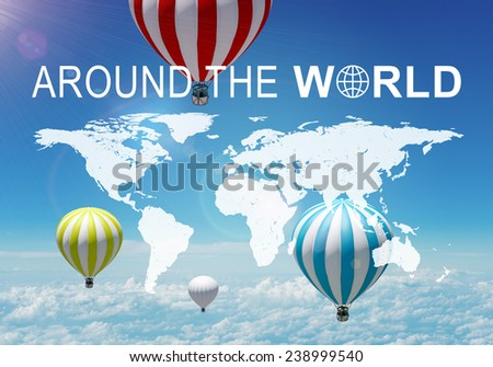 Contoured map of world continents with inscription Around The World and related symbol. Aerial view of a few air baloons, sky and cloud layer as backdrop - stock photo
