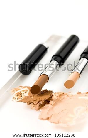 contouring cream stick, beauty treatment on face - stock photo