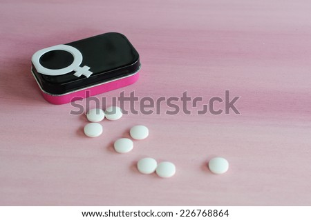 Contraceptive pills box with gender symbol on pink background - stock photo