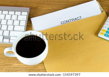 contract and coffee cup on the table.