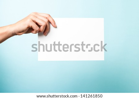 Contract concept. Hand holding white paper card.