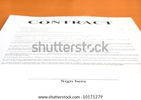 "Contract document. Shallow depth of field, focus on ""Sign here"" text"