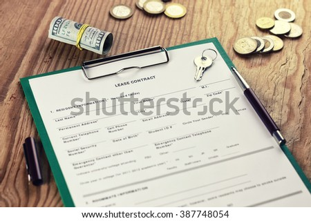 contract lease key money pen  - stock photo