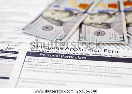 contract mortgage bills in the background - stock photo