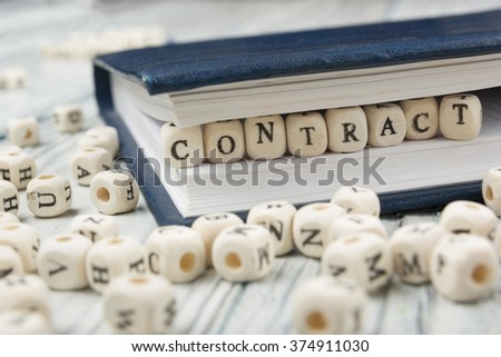 contract word written on wood block. wooden ABC - stock photo