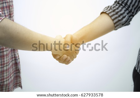 Contractor and company executive sealing a deal shaking hands. Concept of new job opportunities and city development, Close-up of business people handshaking over helmets, documents, worker tool