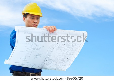 Contractor holding blueprint blue sky background stock photo safe contractor holding blueprint with blue sky background malvernweather Choice Image
