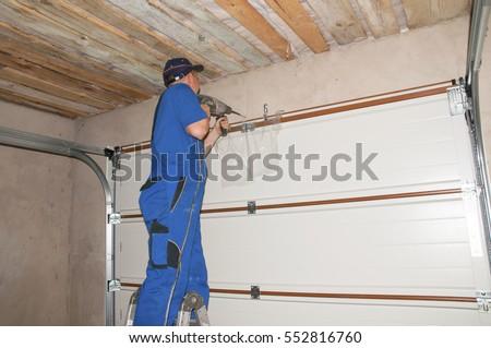 contractor installing garage door opener garage door springs garage door replacement garage door