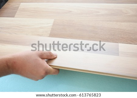 Contractor Installing Wooden Laminate Flooring Insulation Stock