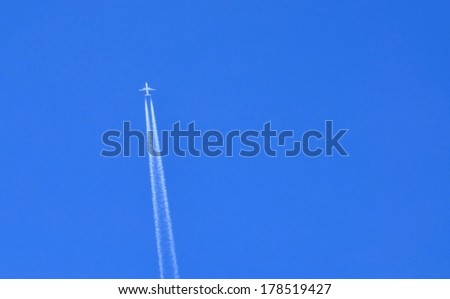 Contrail and aircraft with space for text