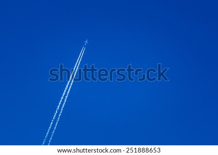 Contrail In Blue Sky. Plane, Clear Sunny Sky Background