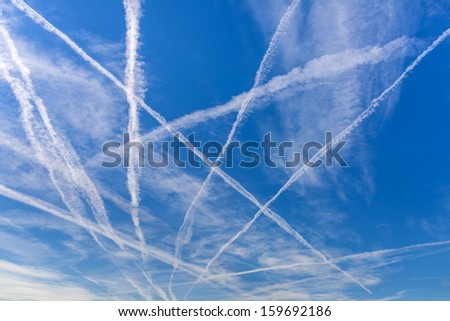 Contrails over blue sky.