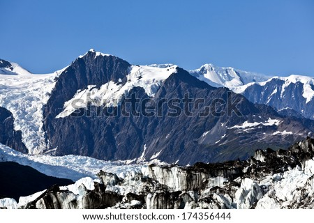 Contrast between rock and snow at College Fjord - stock photo