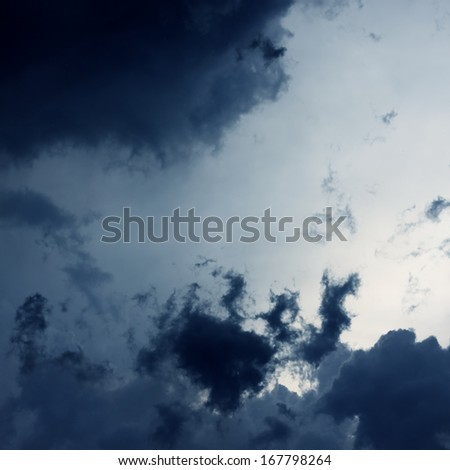 Contrast clouds in the stormy sky - stock photo