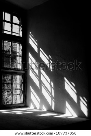 Contrast light from a window in the castle in Lviv - stock photo