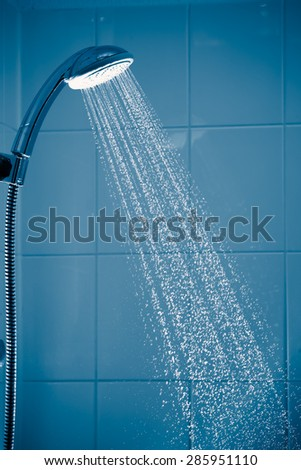 contrast shower with flowing water - stock photo