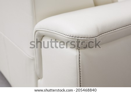 contrasting seam - upholstered furniture - stock photo