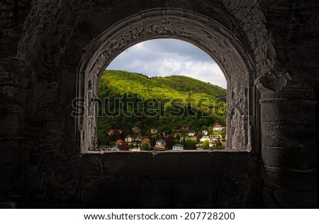 Contrasting view from inside ancient Castle at vivid Heidelberg, Germany