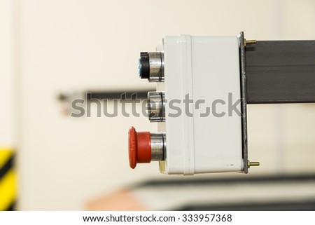 Control box, for the hydraulic lift, with red and green buttons and lock. - stock photo