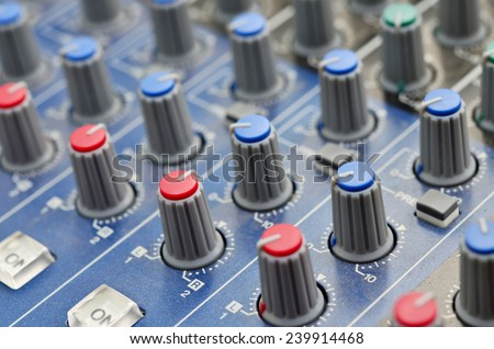 Control buttons for electronic sound. A sliders of a mixing console. Audio signals modifications to achieve the desired output. Applied in recording studios, broadcasting, TV and film production - stock photo